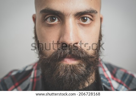 hipster long bearded and mustache man with shirt squares - stock photo