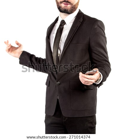 Hipster man in a classic suit isolated on a white background with a telephone in hand. High resolution.