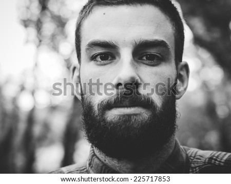Hipster man portrait  in black and white in horizontal composition.
