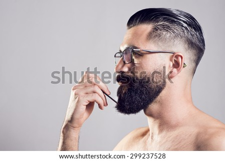 Hipster man posing in studio shot, closeup portrait. Head shot. 35 - stock photo