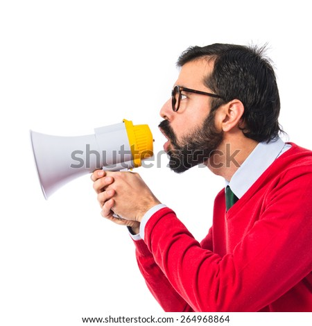 Hipster man shouting by megaphone