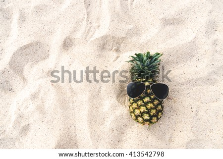 Hipster pineapple on beach - fashion in summer. vintage filter effect - stock photo