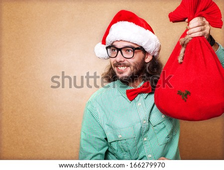 Hipster Santa Claus with the bag of the presents