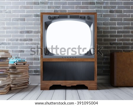 Hipster-screen TV with mockup. Vintage TV on a brick wall background. Around the TV of old books and a suitcase.