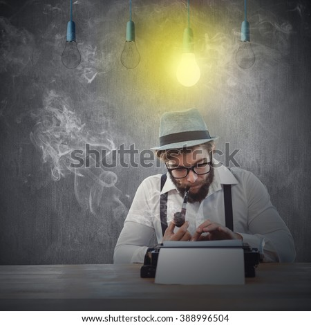 Hipster smoking pipe while working at desk against white and grey background - stock photo