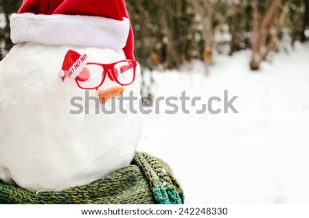 Hipster snowman with nerd glasses - stock photo