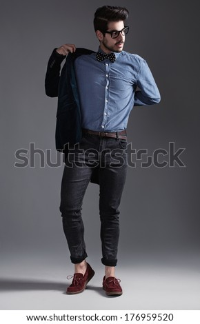 hipster style dressed young guy posing for camera - stock photo