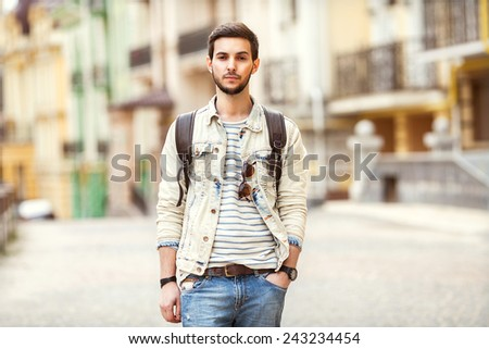 Hipster style guy with casual clothes walk in Europe Portrait of attractive man with casual clothes walk in Europe - stock photo