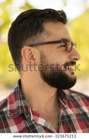 Hipster style man in closeup portrait with day light