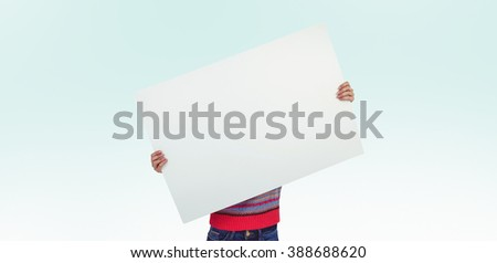 Hipster woman behind a big white card against blue background