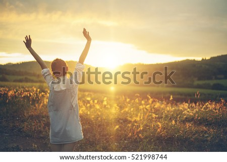 Hipster,Young girl wear overall enjoying sunset on peak of mountain