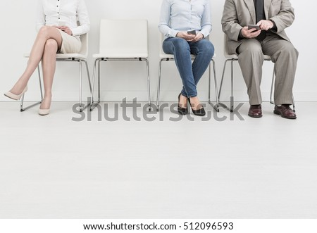 hire employment employ interview candidate hiring legs business waiting cv women sitting queue group employer elegant executive caucasian female male indoors men colleague room concept - stock image