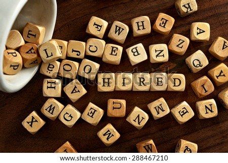 HIRED word concept on wood blocks - stock photo