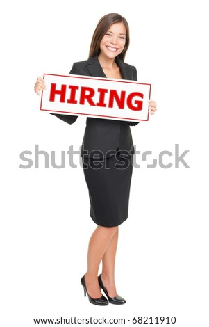 Hiring job woman holding hiring sign. Young attractive smiling Caucasian / Asian businesswoman isolated on white background.