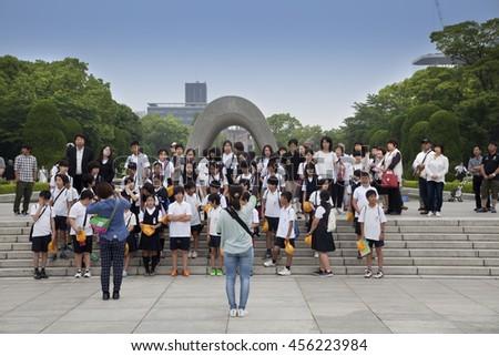 HIROSHIMA, JAPAN- MAY 27: School kinds in Hiroshima Peace Memorial Park (Atomic Bomb Dome) on May 27,2016 in Hiroshima, Japan. - stock photo
