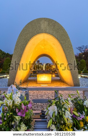 HIROSHIMA JAPAN - NOV 19 2015: Hiroshima peace memorial park statue at dusk. Park is a memorial park dedicated to the legacy of Hiroshima as the first city in the world to suffer a nuclear attack.