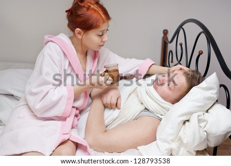 His wife cares for sick husband colds - stock photo