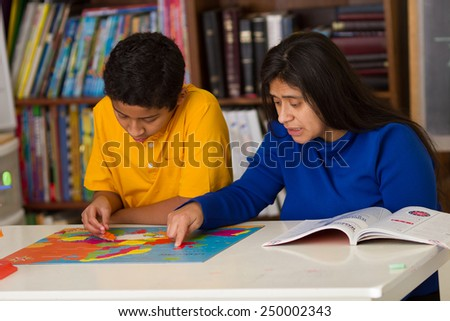 Hispanic Boy and Mom Working on Puzzle