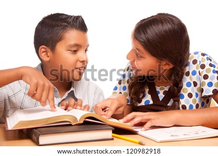 Hispanic Brother and Sister Having Fun Studying Together Isolated on a White Background. - stock photo