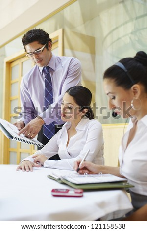 Hispanic business people working together in an office