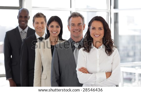 Hispanic Business woman leading a team of workers - stock photo