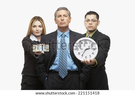 Hispanic businesspeople with clock and money