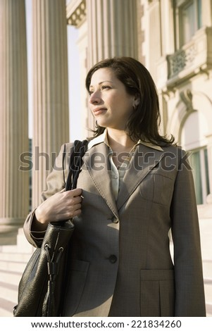 Hispanic businesswoman in front of building - stock photo