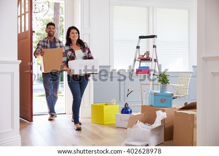 Hispanic Couple Moving Into New Home Together - stock photo
