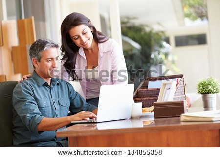 Hispanic Couple Names Hispanic Couple Using Laptop