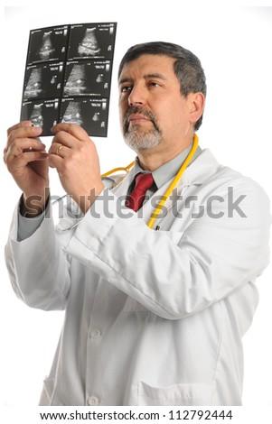 Hispanic doctor examining ultrasound film isolated over white background - stock photo