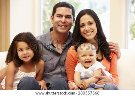 Hispanic family at home - stock photo