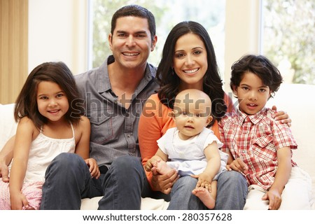 Hispanic family at home - stock photo