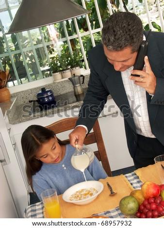 Hispanic family having breakfast in a kitchen. - stock photo