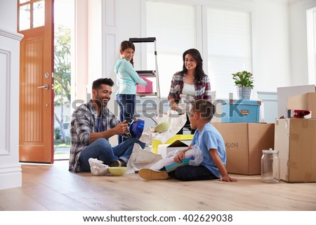 Hispanic Family Moving Into New Home - stock photo