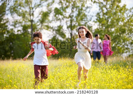 Hispanic Family Walking In Countryside - stock photo