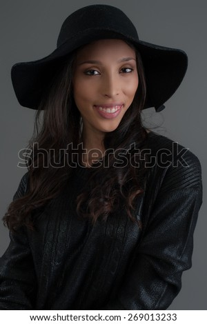 Hispanic fashion model posing at studio. Close up portrait.