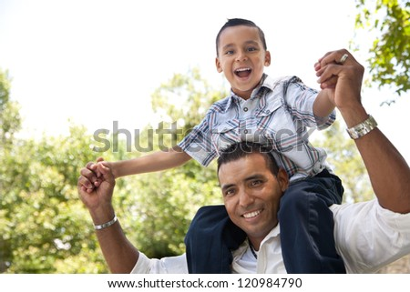 Hispanic Father and Son Having Fun Together in the Park.