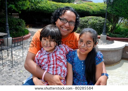 Hispanic father with two kids - stock photo