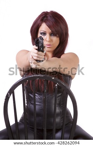 Hispanic girl with guns on a chair isolated white background - stock photo
