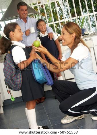 Hispanic little girls going to school. - stock photo
