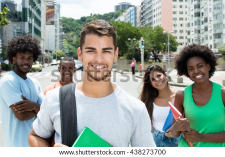 Hispanic male student with international friends - stock photo
