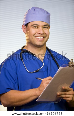 Hispanic male wearing scrubs with stethoscope around neck.