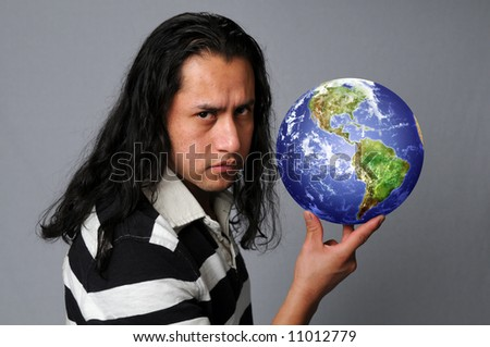 Hispanic man holding the earth with his fingers
