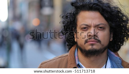 Hispanic man in city face portrait serious face