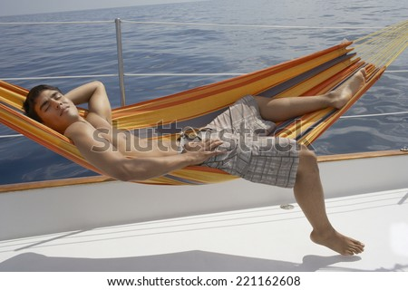 hispanic man laying in hammock on boat man laying on side stock images royalty free images  u0026 vectors      rh   shutterstock