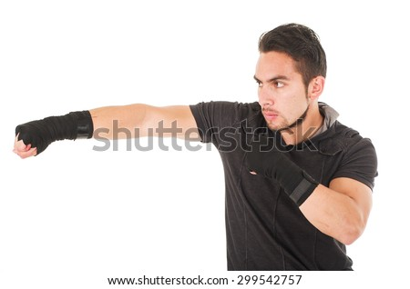 hispanic man martial arts fighter wearing black t-shirt punching isolated on white