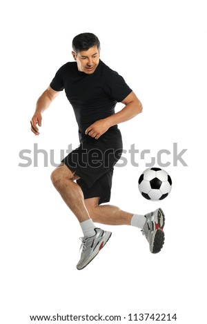 Hispanic man playing with soccer ball isolated over white background - stock photo