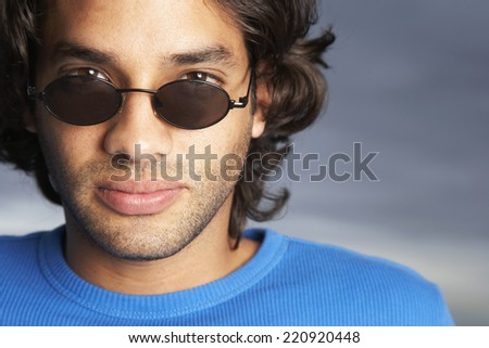 Hispanic man wearing sunglasses