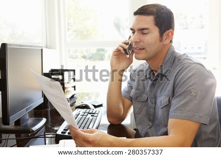 Hispanic man working in home office