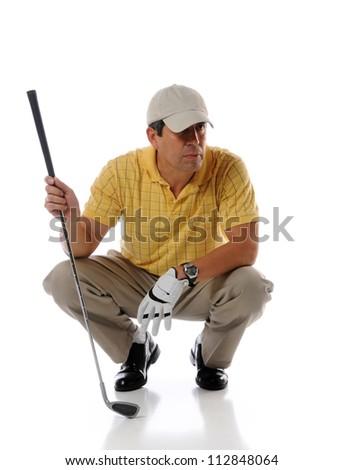 Hispanic mature golfer holding patter isolated over white background - stock photo